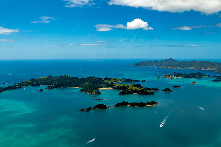 Islands in the ocean seen from the air, Bay of Islands, New Zealand