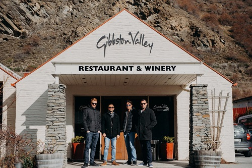 A group of men standing in the entrance of Gibbston Winery near Queenstown, New Zealand