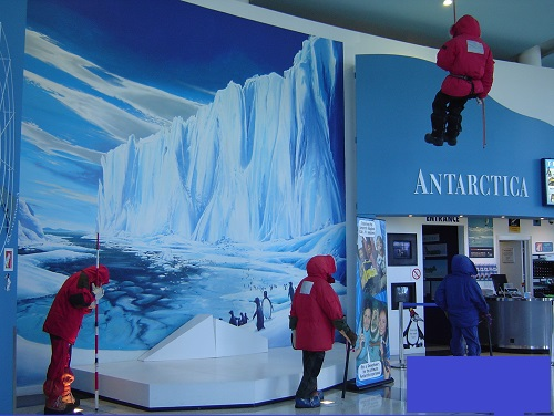 People in anoraks at an Antarctic exhibition museum