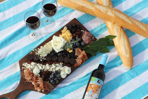 Bread, cheese, snacks and wine on a table