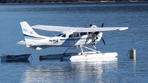 Light aircraft hovering over lake