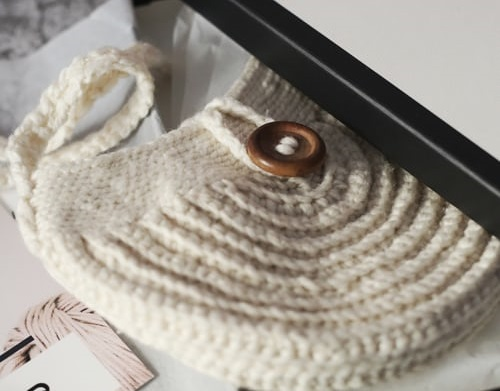 Knitted wool bag with button